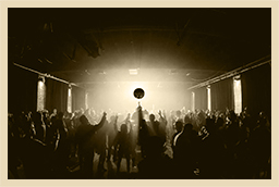 crowd in nightclub under disco ball